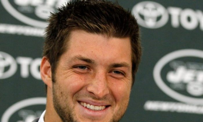 Tim Tebow brings his fourth-quarter heroics to the Jets this season.( Mike Stobe/Getty Images)