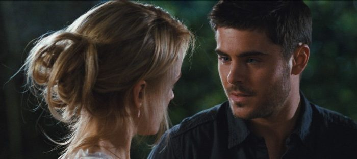 """Taylor Schilling and Zac Efron in the drama """"The Lucky One,"""" a film about a Marine who after serving three tours in Iraq searches for the woman he believes brought him good luck during the war. (Warner Bros. Pictures)"""