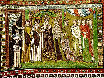 THE EMPRESS: A mosaic depicts Byzantine Empress Theodora accompanied by ladies and eunuchs of the court in San Vitale in Ravenna, Italy. (Neuceu/WikiMedia Commons)