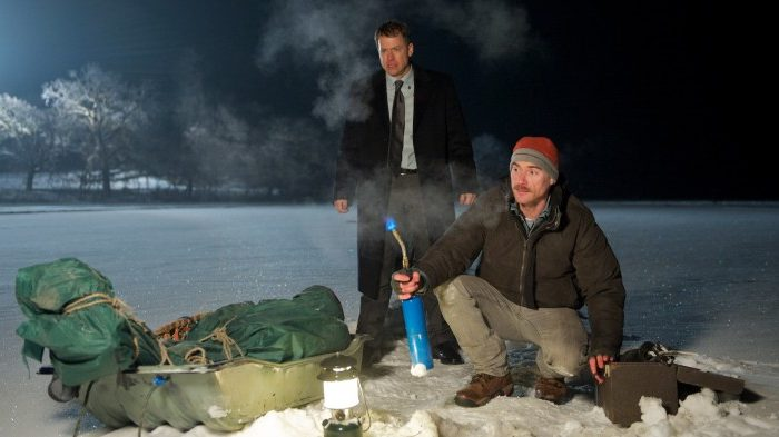 """Greg Kinnear as an insurance agent black mailed by Billy Crudup, as the unstable locksmith (front), into stealing a rare violin from a retired farmer in the comedy-drama """"Thin Ice."""" (Wilson R. Webb / ATO Pictures)"""