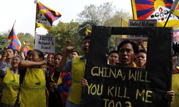 Tibetan activists shout slogans during a protest outside the United Nations office in New Delhi on March 6. A teenager has become the third Tibetan to self-immolate in China in as many days, exile groups said. (Manan Vatsyayana/AFP/Getty Images)
