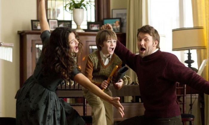 Jennifer Garner, CJ Adams, and Joel Edgerton (R) in the dramatic comedy-fantasy 'The Odd Life of Timothy Green,' a film about a childless couple who wish for an infant and receive a child who is not all that he appears. (Phil Bray/ Disney Enterprises, Inc.)