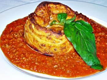 BAKED GOODNESS: This Timballo, a perennial favorite was wondrous, and is served with a light bechamel sauce. (Nadia Ghattas/Epoch Times)