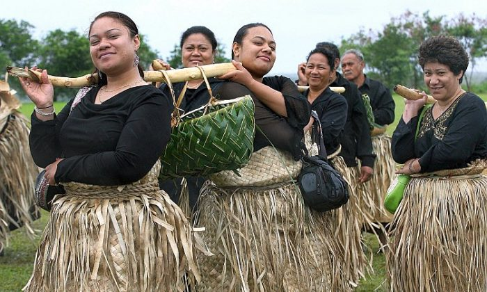 Women in traditional dress deliver a specially prepared lunch to the royal household in Nukualofa, Tonga, on Sept. 20, 2006. (Greg Wood/AFP/Getty Images)