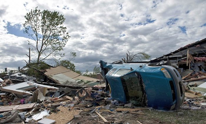 Damage is seen after an EF3 tornado swept through the Pinaire Mobile Home Park on April 15 in Wichita, Kan. The storms were part of a massive system that affected areas from Northern Nebraska and Iowa south through Oklahoma. (Julie Denesha/Getty Images)