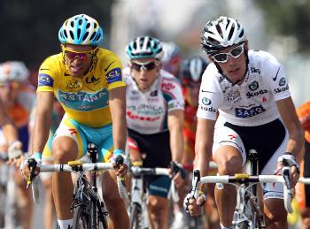 Alberto Contador (L) crosses the finish line alongside Andy Schleck in Stage Sixteen of the 2010 Tour de France. (Bryn Lennon/Getty Images)