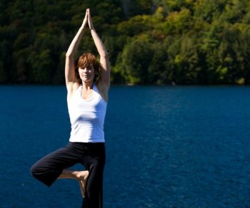 TREE POSE: Also known as Vrksasana. It is great to help develop balance, stronger feet, and ankles, and for relieving sciatica.  (Photos.com)