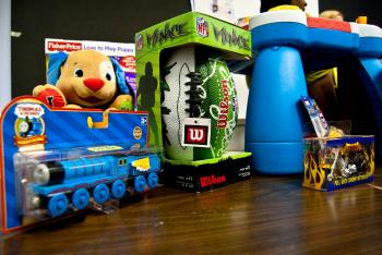 Toys deemed harmful to children that were found on store shelves in New York are on display at a Dec. 2 press conference. (Joshua Philipp/The Epoch Times)