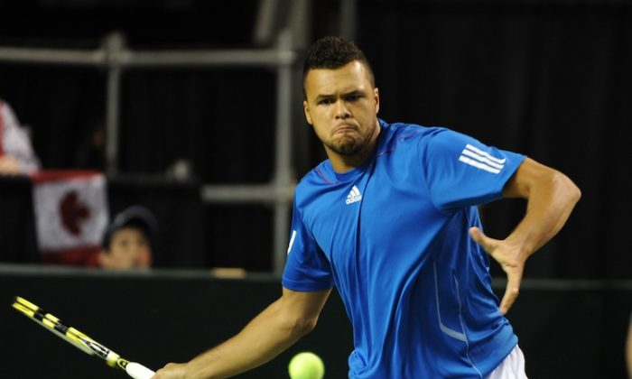 France won the critical doubles match on Saturday over Canada. (Don MacKinnon/AFP/Getty Images)