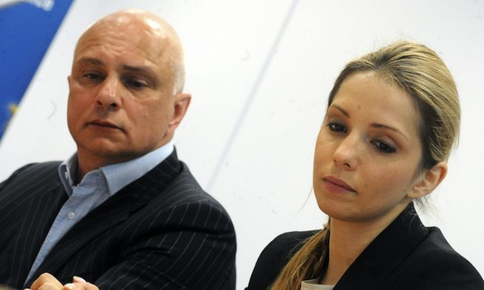 Oleksander Tymoshenko (L), the husband of jailed Ukrainian ex-premier Yulia Tymoshenko and their daughter Eugenia Tymoshenko give a press conference in Prague April 30. Ukraine's prison service on April 29 cast doubt on claims by jailed ex-premier Yulia Tymoshenko that she was beaten by guards. (Michal Cizek/AFP/GettyImages)
