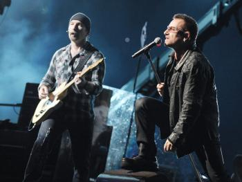 Musician The Edge (L) and singer Bono of U2 perform onstage during their '360 Degrees Tour' at the Rose Bowl on October 25, 2009 in Pasadena, California. U2 will be rescheduling their North American tour, following Bono's recent back surgery. (Kevin Winter/Getty Images)