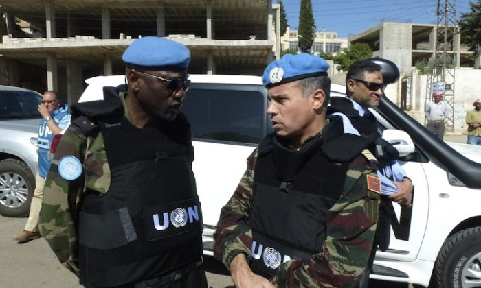Moroccan Colonel Ahmed Himmiche, head of the UN observers' advance team (R) speaks with Senegalese Lieutenant-General Babacar Gaye, military adviser of the UN secretary general (L) in Zabadani, northwest Damascus on May 20. (-/AFP/GettyImages)