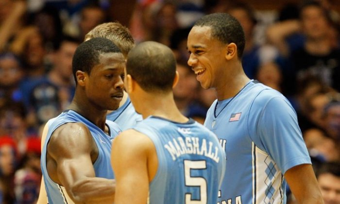 North Carolina's trio of Harrison Barnes (L), Kendall Marshall (C), and John Henson (R) led the program to 61 wins over the last two seasons. (Streeter Lecka/Getty Images)