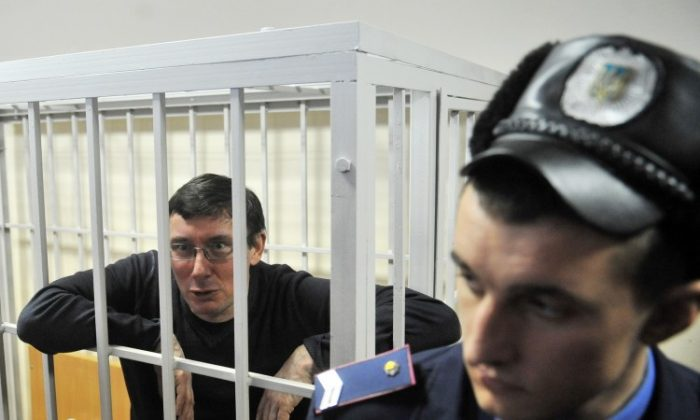 Former Ukrainian Interior Minister Yuriy Lutsenko , sits in a cage inside the courtroom during his verdict hearing on Feb 27. (Sergei Supinsky/AFP/Getty Images)