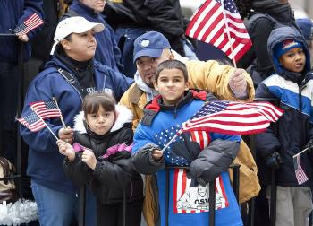 Families gathered along the parade route at Wednesday's parade to cheer our military forces. (Edward Dai/The Epoch Times)