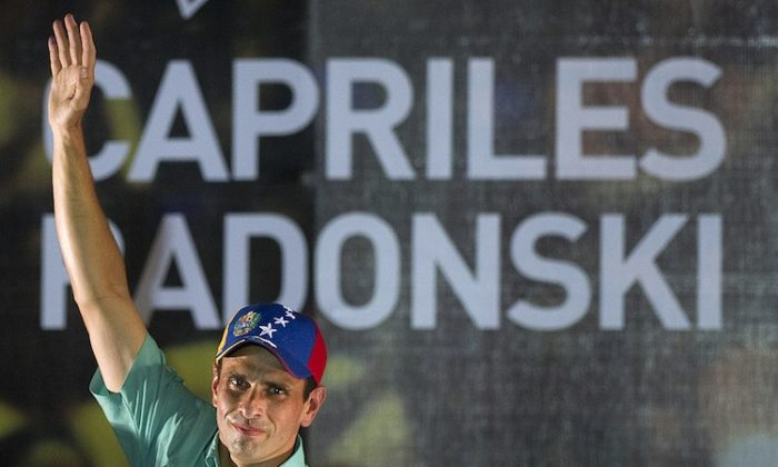 Venezuelan opposition leader Henrique Capriles Radonski celebrates after winning the primary elections in Caracas on Feb. 12. (Juan Barreto/AFP/Getty Images)