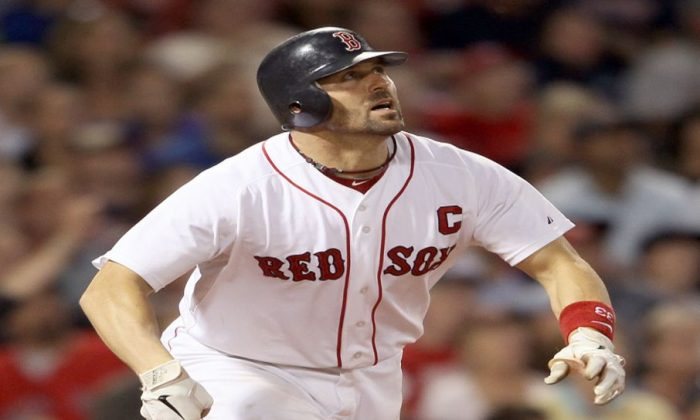 Varitek was the Red Sox catcher for 14 years and won two World Series titles. (Elsa/Getty Images)