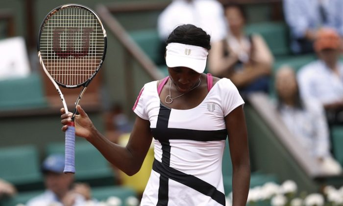 Venus Williams was bounced in her first Grand Slam appearance of 2012. (Kenzo Tribouillard/AFP/GettyImages)