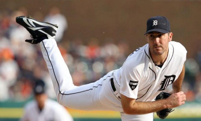 Verlander led the league in wins, strikeouts, and ERA in 2011, netting him both the Cy Young Award and MVP. (Leon Halip/Getty Images)