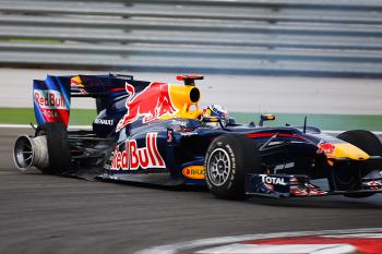 Sebastian Vettel sits on the side of the track after hitting teammate Mark Webber. (Mark Thompson/Getty Images)