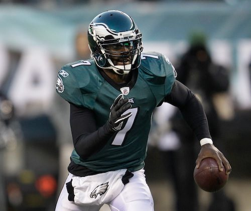 Michael Vick ran for 32 yards and a score against the Jets. (Rob Carr/Getty Images)