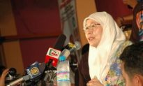 Malaysia's Opposition Leader Resigns to Make Way for Husband