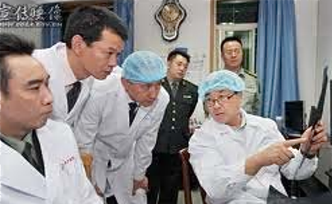 """Wang Lijun is pictured showing military officials through his laboratory in Jinzhou City, Liaoning Province, which he ran out of the Public Security Bureau when he was PSB chief there. According to a 2006 admission, he conducted """"thousands"""" of executions and organ transplantations. (Courtesy of WOIPFG)"""