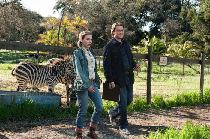 man, woman, and zebra in We Bought a Zoo