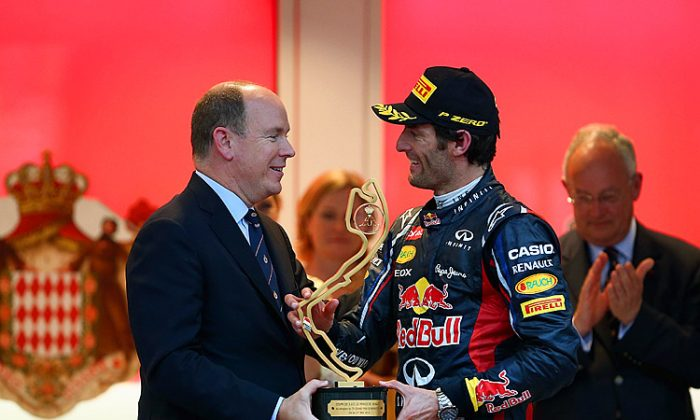 Mark Webber of Red Bull Racing receives the winner's trophy from Prince Albert II of Monaco after winning his second Formula One Monaco Grand Prix. (Clive Mason/Getty Images)