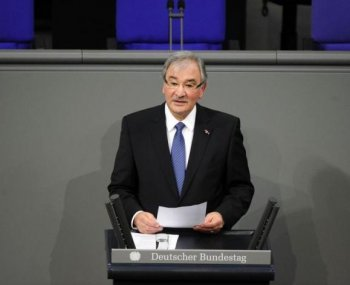 Dutch-born Roma Holocaust survivor Zoni Weisz addresses Germany's Lower House of Parliament during an official Holocaust ceremony in Berlin on Jan. 27. About one-third of Roma and Sinti people are estimated to have been killed by the Nazis during World War II. (John MacDougall/AFP/Getty Images)