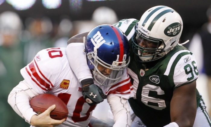 The Jets first round pick in 2011, Muhammad Wilkerson (R), had a lukewarm season in 2011 though it's too early to see how good he'll become. (Rich Schultz/Getty Images)