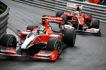 Ferrari's Fernando Alonso chases Virgin Racing's Luca di Grassi during the Monaco Grand Prix. (Fred Dufour/AFP/Getty Images)