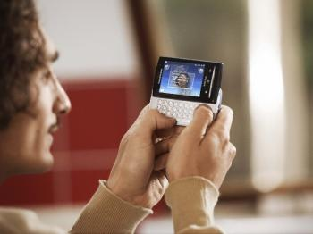 SMALL ANDROID: A man uses the QWERTY keyboard of a Sony Ericsson Xperia X10 Mini, which is one of the smallest Android smartphones available. (SONY)