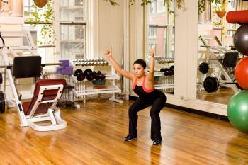 When performing a body weight squat, try raising your arms overhead into a 'Y' position to help lengthen and strengthen your back. (Henry Chan/ The Epoch Times )