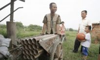 Chinese 'Cannoneer' Fends Off Forced Demolition