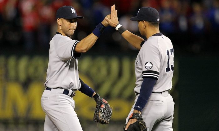 Derek Jeter (L) and Alex Rodriguez (R) have been to the playoffs seven of the eight seasons they've been teammates. (Ronald Martinez/Getty Images)