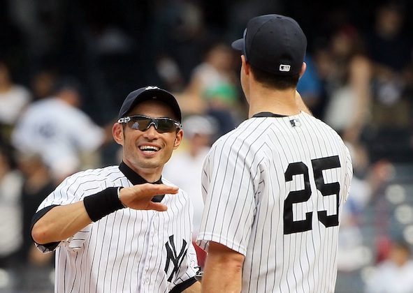 Ichiro Suzuki (L) and Mark Teixeira each had a hit in the Yankees' win. (Jim McIsaac/Getty Images)