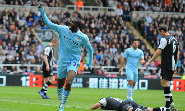 Manchester City's Yaya Toure celebrates his second goal in beating Newcastle. (Andrew Yates/AFP/GettyImages)