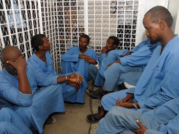 Suspected Somali pirates sit in a cell at the Yemeni state security court in Sanaa on September 29, 2009, during the first hearing in their trial. (Khaled Fazaa/AFP/Getty Images)