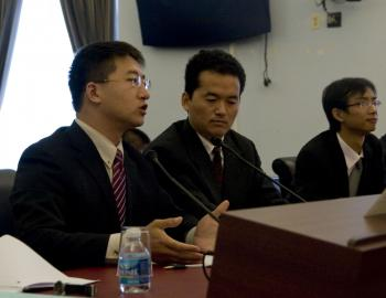 BRINGING LAW TO CHINA: Defense lawyers Zhang Kai (far left), and Dai Jinbo (far right) from China testify of their struggles to practice law in the legal environment of China. They spoke through the interpreter (middle) on Oct. 29 on Capitol Hill. (Lisa Fan/Epoch Times)