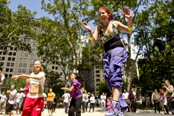 DANCE STEP: Sarah Rozek (R) does a dance step and clap with fellow teachers Irena Meletiou(L) and Gabriella Sorentino(M) following along with the rest of the crowd at Madison Square Park on Monday. (Phoebe Zheng/The Epoch Times)