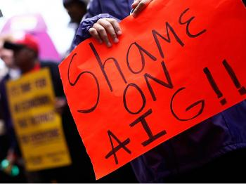 Protesters demonstrate outside an AIG office in Washington, DC. (Win McNamee/Getty Images)