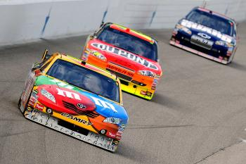 Kyle Busch in the #18 M&M's Toyota, leads Jeff Gordon's #24 DuPont Chevrolet, and Dale Earnhardt Jr's #88 National Guard/AMP Energy Chevrolet. (Robert Laberge/Getty Images for NASCAR)
