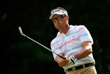 Robert Allenby watches his tee shot on the eighth hole during the first round of The Players Championship at TPC Sawgrass. (Sam Greenwood/Getty Images)