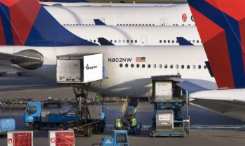 Aircraft from Delta-Northwest are being supplied and loaded before departure at Schiphol Airport, near Amsterdam on December 26, 2009. The United States has asked airlines worldwide to tighten security after a Nigerian tried to blow up a U.S. airliner he boarded in Amsterdam, Dutch authorities said today. (Marcel Antonisse/AFP/Getty Images)