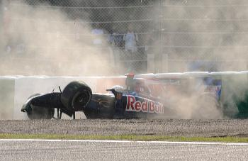 Toro Rosso driver Jaime Alguersuari of Spain crashes into the tire barrier during qualifying for the Formula One Japanese Grand Prix. (Toru Yamanaka/AFP/Getty Images)