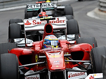 Fernando Alonso leads Michael Schumacher at the Formula One Monaco Grand Prix. (Gerard Julien/AFP/Getty Images)