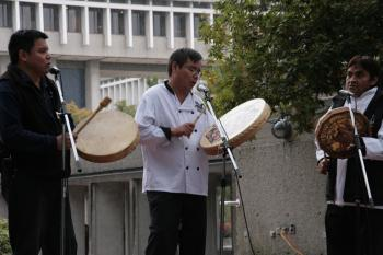 Gary George from the First Nations Students Centre (far left) leads a round of traditional West Coast Salish drumming songs.  (Andrea Hayley/The Epoch Times)