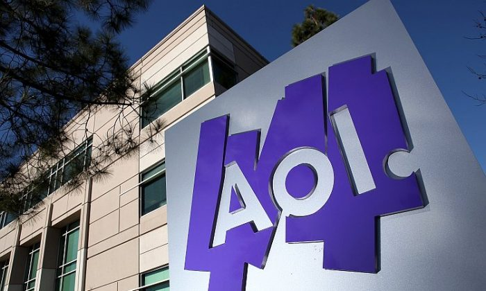 The AOL Inc. logo is displayed in front of its offices in Palo Alto, Calif., in February 2011. On Monday, AOL said it is selling 800 technology patents to Microsoft Corp. for $1 billion in cash. (Justin Sullivan/Getty Images)