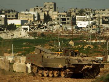 An Israeli armored personnel carrier waits near the Gaza-Israeli border in Israel, January 13, 2009. (Spencer Platt/Getty Images)